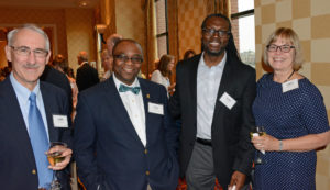 Pictured (LtoR) John O'Hara, Cristo Rey Jesuit High School tutor; Greg Sucre, Cristo Rey Jesuit High School Dean of Teaching & Learning; Walter Reap, Cristo Rey Jesuit High School principal; and Carol Baumerich, US Occupational Safety & Health Review Commission administrative law judge