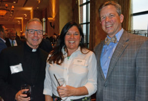 Pictured (LtoR) Fr. John Savard, S.J. Loyola University Maryland rector; Laura Day, former Notre Dame Preparatory School counselor; and Anthony Day, Loyola Blakefield president