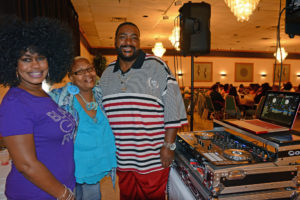 Pictured (LtoR) Scotta Norris, US Department of Labor Job Corps records manager; LaVerne Young, Augsburg Lutheran Home geriatric nursing assistant; and DJ Sugar Chris, who has deejayed the crab feast for its entire 14 years