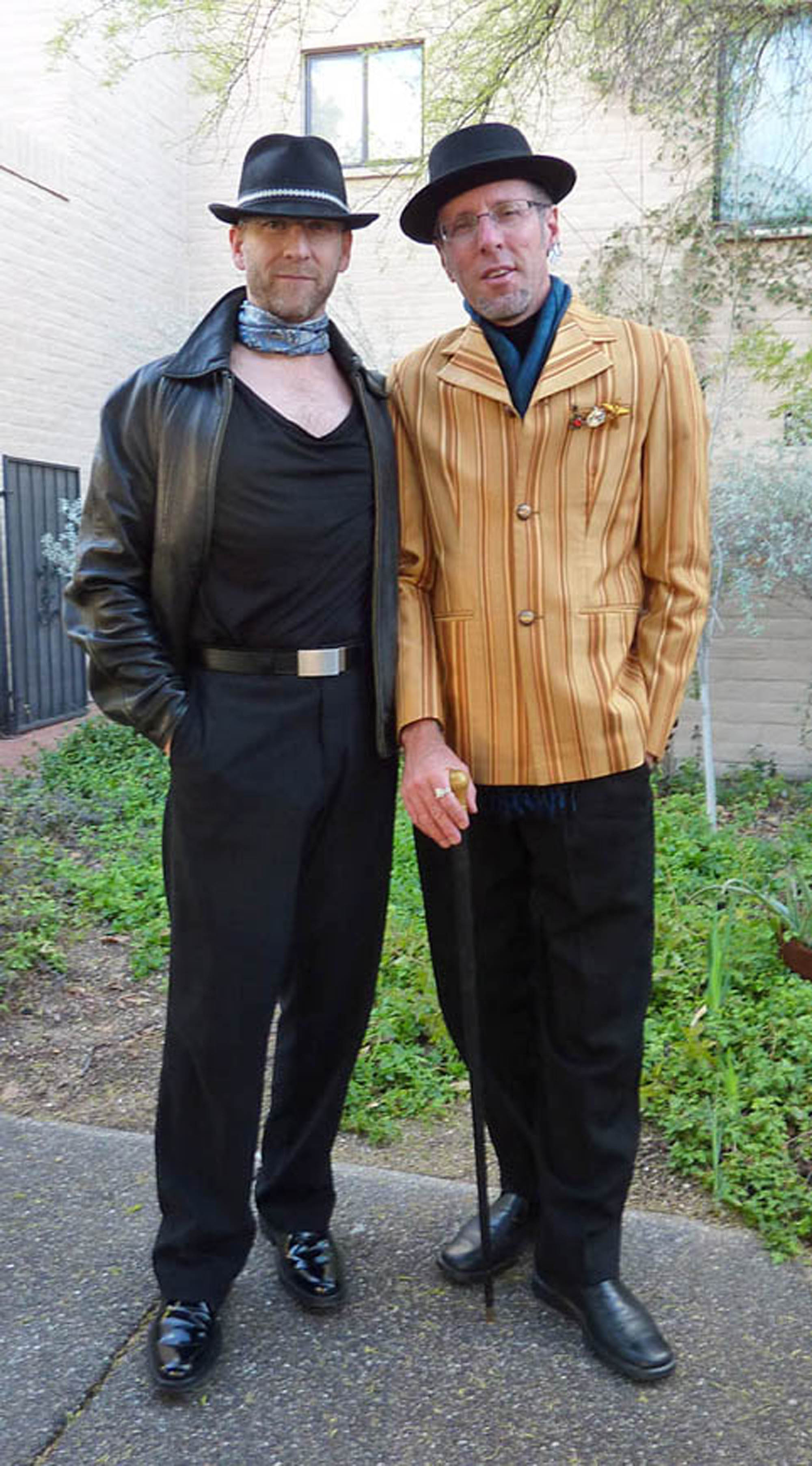 Not ones to let the ladies get all the attention, Tucson natives David Gilmore and Michael Baun were stepping out in dandy style. David is wearing a mustard-striped jacket he designed himself and had custom-made in Thailand – he says he gets a lot of clothes made there – and Michael is wearing a vintage-contemporary combo all in black. Both men are sporting cravats. The pork pie hat is one of Gilmore's signatures, the walking stick a fashion fillip!