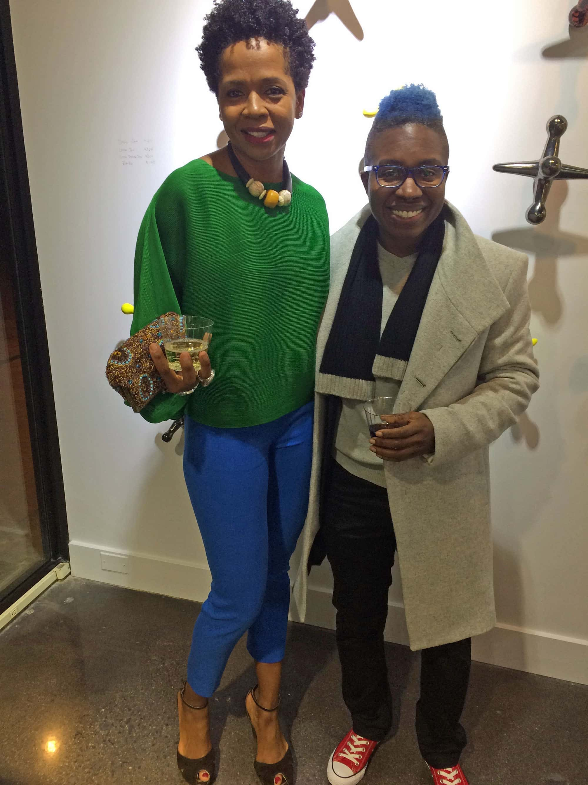 Also in attendance were Dahlia Woody and her partner Q Ragsdale. Dahlia said she couldn't remember where she got her vivid green-and-blue ensemble. But there was no mistaking who made Q's classic red low-top Chuck Taylors – Converse. Q's sculptural wool felt coat is from Zara.