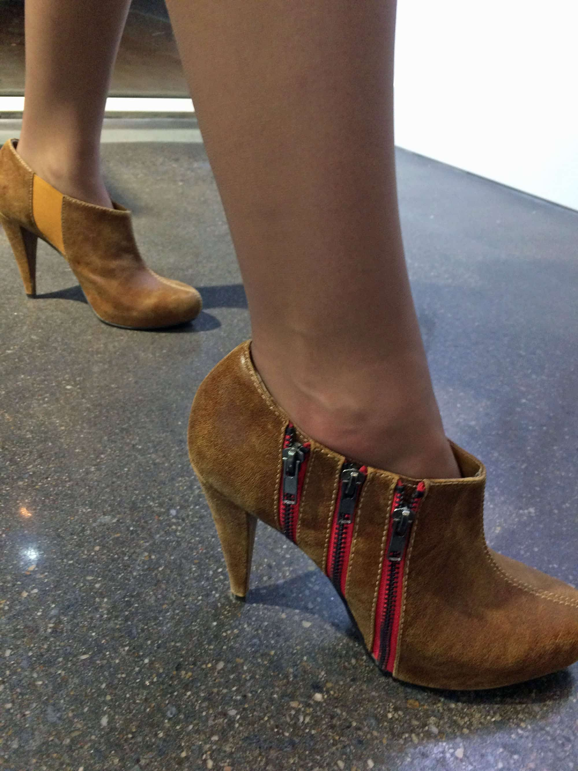 Also wearing Steve Madden shoes was Katie Caljean – tan suede booties with three bright red zippers.